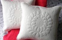 Trapunto feathered wreath pillow