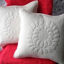 Trapunto feathered wreath pillow